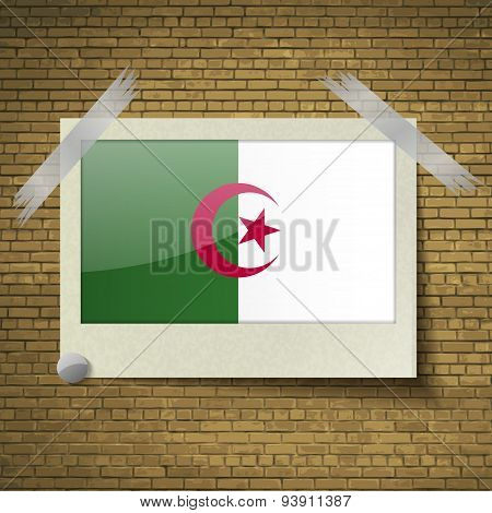 Flags Algeria At Frame On A Brick Background. Vector