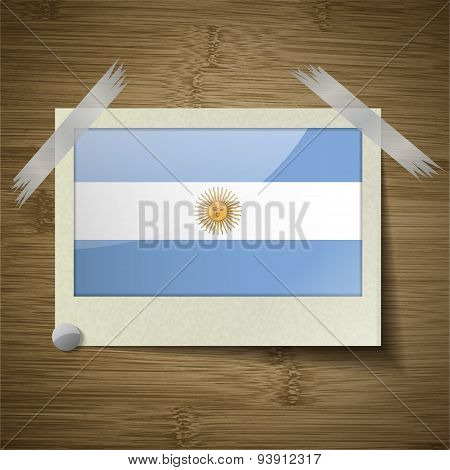 Flags Of Argentina At Frame On Wooden Texture. Vector