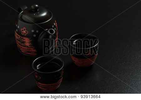 Black Teacups And Pot