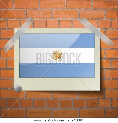 Flags Of Argentina Scotch Taped To A Red Brick Wall