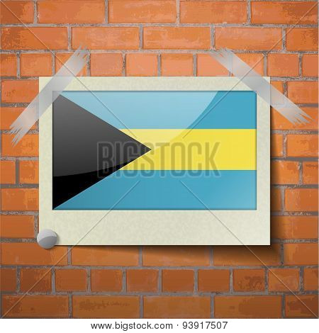 Flags Bahamas Scotch Taped To A Red Brick Wall