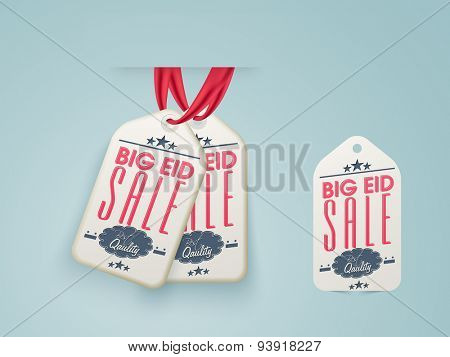 Stylish hanging big sale tags for muslim community festival, Eid Mubarak celebration.