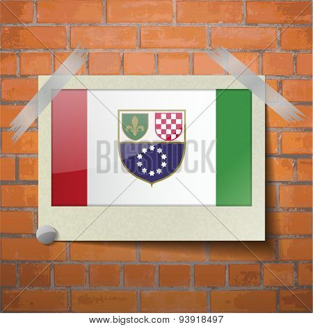Flags Bosnia And Herzegovina Federation Scotch Taped To A Red Brick Wall