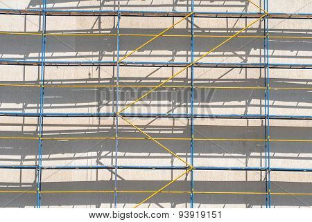 scaffolding for finishing work the walls of a multistory building
