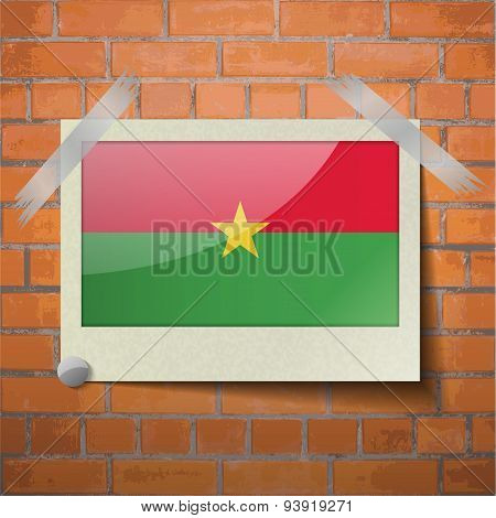 Flags Burkia Faso Scotch Taped To A Red Brick Wall