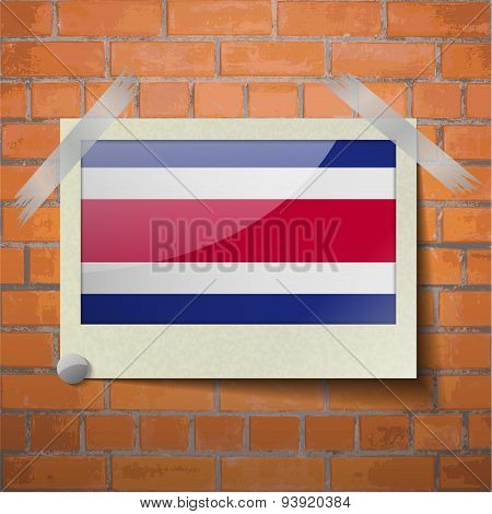 Flags Costa Rica Scotch Taped To A Red Brick Wall