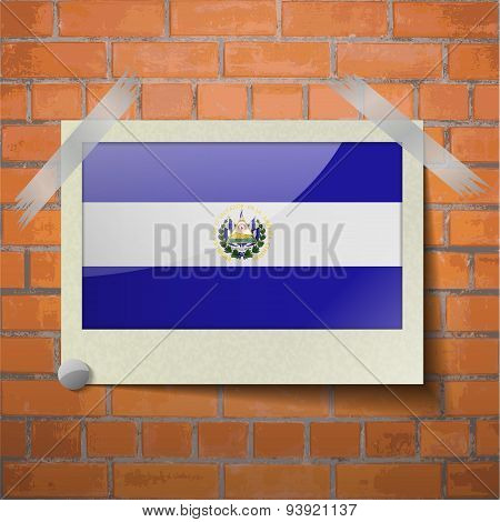 Flags El Salvador Scotch Taped To A Red Brick Wall