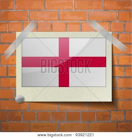 Flags England Scotch Taped To A Red Brick Wall