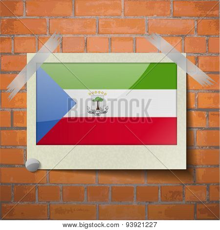Flags Equatorial Guinea Scotch Taped To A Red Brick Wall