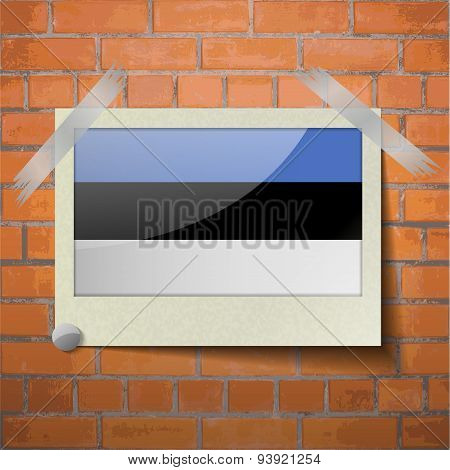 Flags Estonia Scotch Taped To A Red Brick Wall