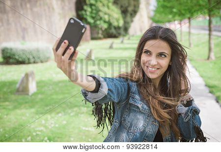Young Brunette Woman Taking A Selfie