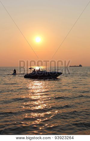 Sunset Family Boating Silhouette