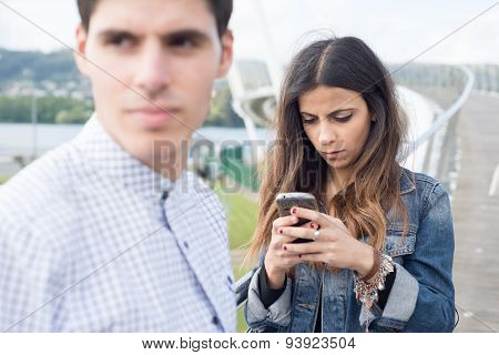 Woman Distracted Looking At Her Smart Phone