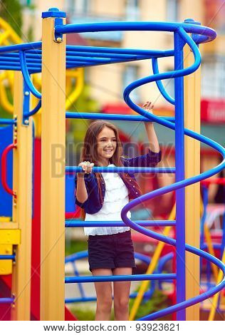 Happy Kid, Girl Climbs On The Stile At Playground