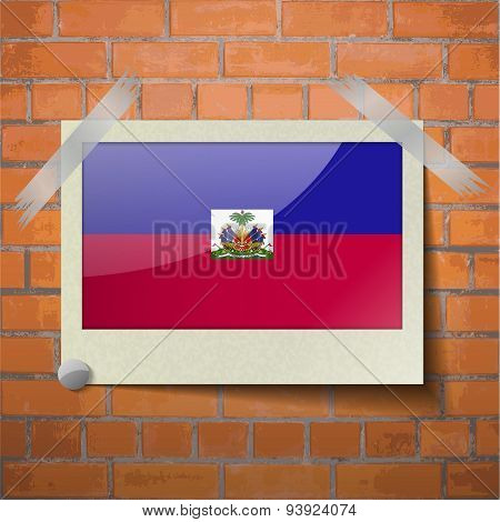 Flags Haiti Scotch Taped To A Red Brick Wall