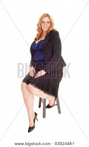 Blond Plus Size Woman Sitting.