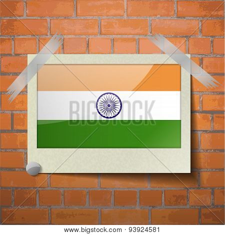 Flags India Scotch Taped To A Red Brick Wall