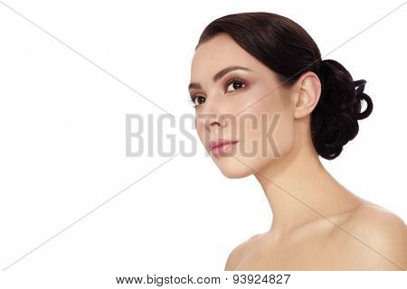 Portrait of young beautiful woman with stylish hair bun over white background, copy space