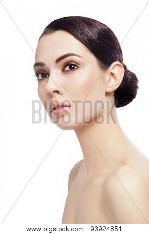 Portrait of young beautiful woman looking upwards over white background