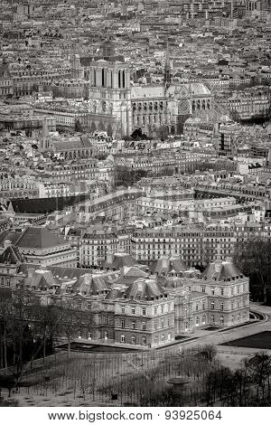 Aerial View Of Paris Rooftops With Notre Dame Cathedral, France