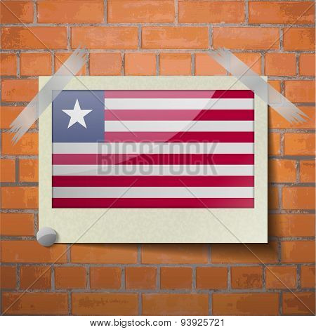 Flags Liberia Scotch Taped To A Red Brick Wall