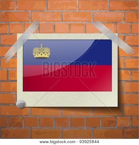 Flags Liechtenstein Scotch Taped To A Red Brick Wall