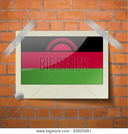 Flags Malawi Scotch Taped To A Red Brick Wall