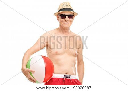 Shirtless senior with sunglasses holding a beach ball and smiling isolated on white background