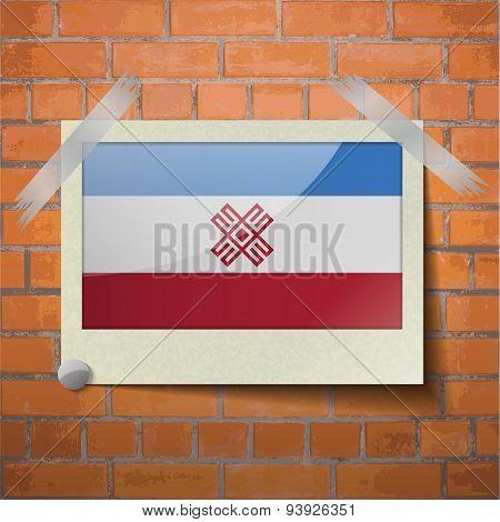 Flags Mari El Scotch Taped To A Red Brick Wall