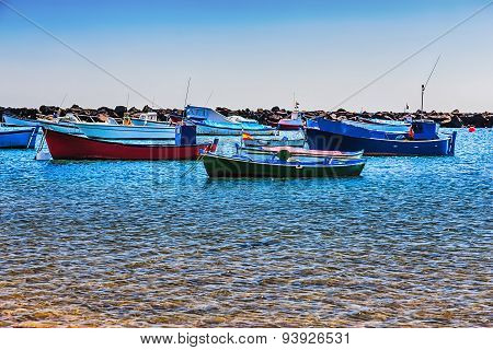 Boats On The Water With Waves