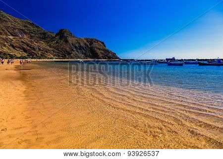 Beach With Waves On Sand And Mountain