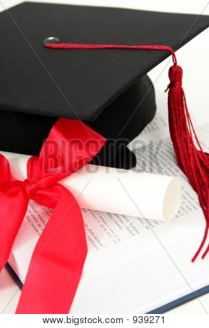Graduation Cap And Diploma On A Book