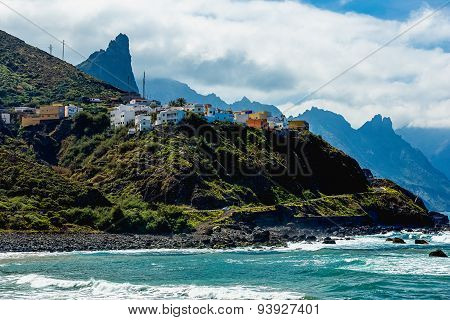 Mountain And Clouds With Small Village