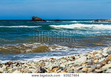 Wild Stone Beach And Rock In Water