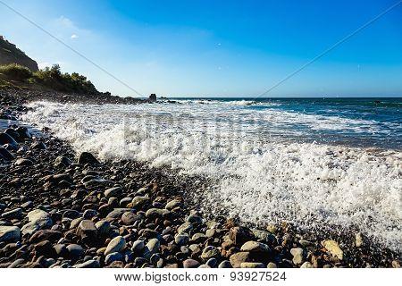 Stone Beach On Shore Of Ocean