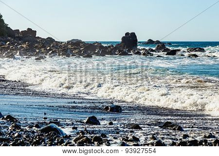 Waves And Rock On Wild Beach