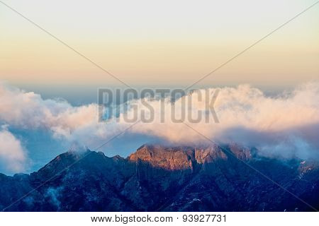 Pink Clouds Over Mountain And Sky Horizon