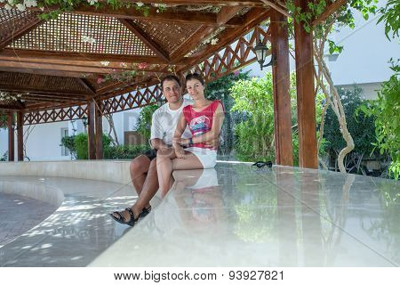 Young couple sitting on the terrace