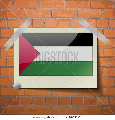 Flags Palestine Scotch Taped To A Red Brick Wall