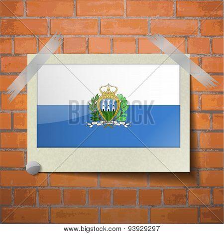 Flags San Marino Scotch Taped To A Red Brick Wall