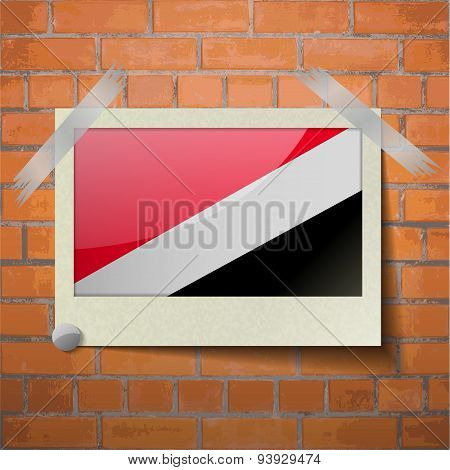 Flags Sealand Principality Scotch Taped To A Red Brick Wall