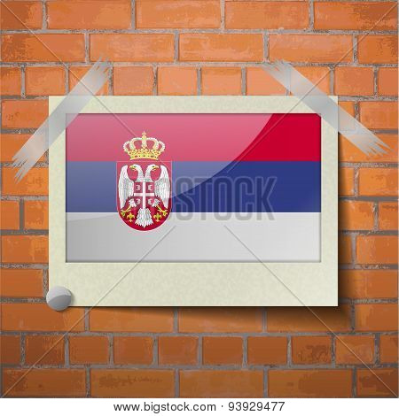 Flags Serbia Scotch Taped To A Red Brick Wall