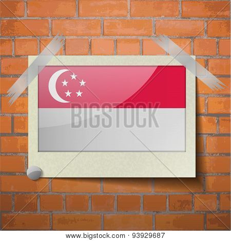 Flags Singapore. Scotch Taped To A Red Brick Wall