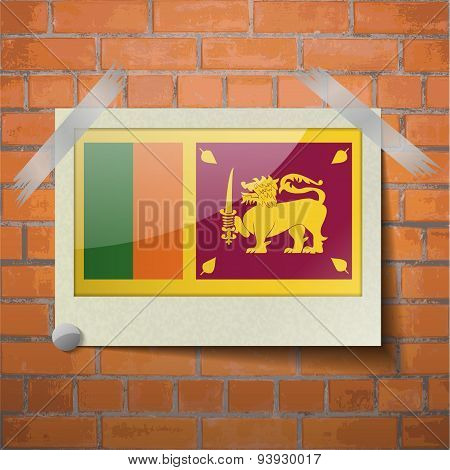 Flags Sri Lanka Scotch Taped To A Red Brick Wall