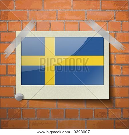 Flags Sweden Scotch Taped To A Red Brick Wall