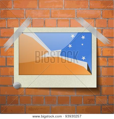 Flags Of Tierra Del Fuego Province Scotch Taped To A Red Brick Wall