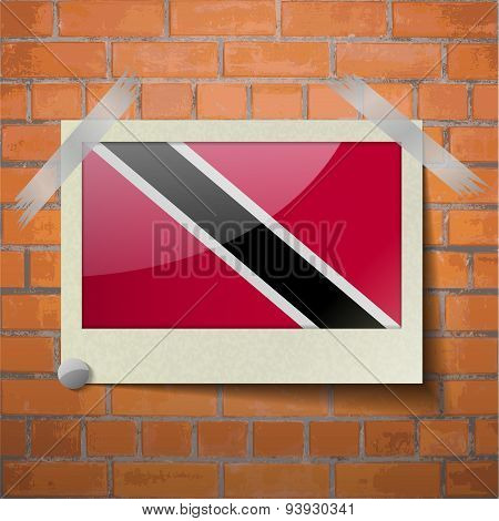 Flags Trinidad And Toba Scotch Taped To A Red Brick Wall