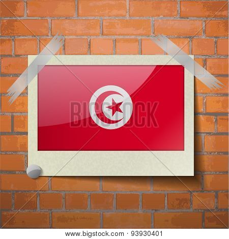 Flags Tunisia Scotch Taped To A Red Brick Wall