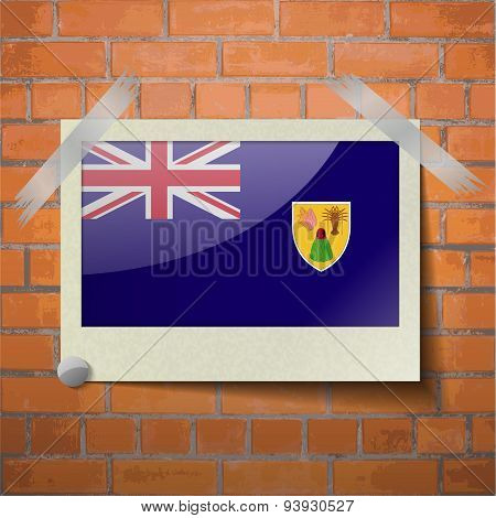 Flags Turks And Caicos Scotch Taped To A Red Brick Wall