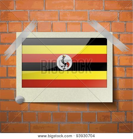 Flags Uganda Scotch Taped To A Red Brick Wall